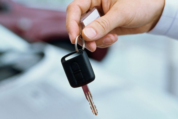 close-up of a person giving car keys to a man